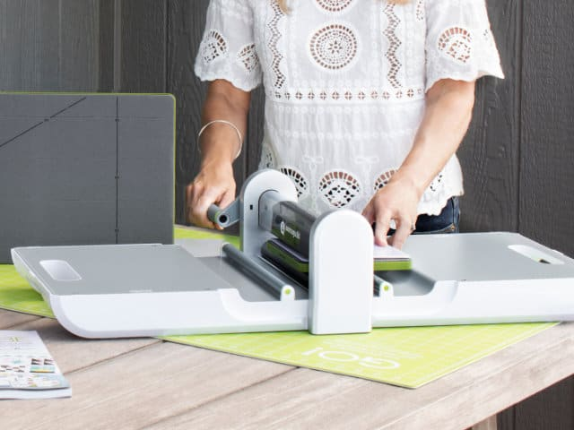 Accuquilt GO cutter in use by a woman