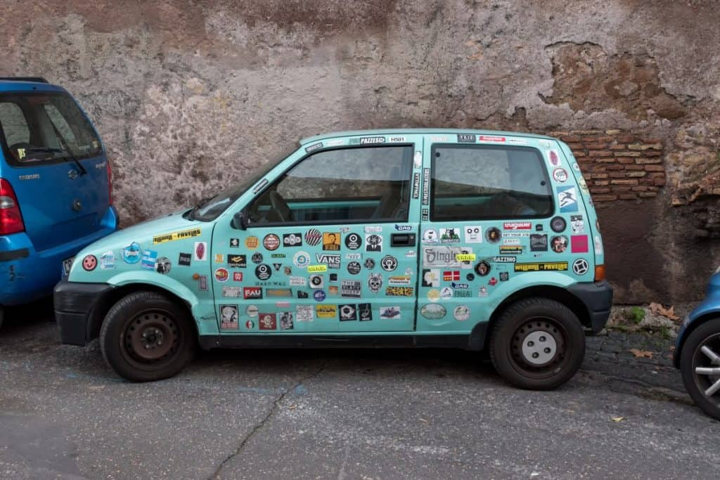 car covered in stickers decals